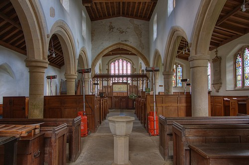 View down nave to chancel with the remains of painting above chancel arch