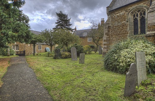 The churchyard, the old school can be seen on left and vicarage in middle of picture