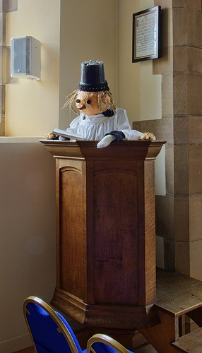 The pulpit and an odd looking rector!